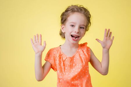 bright picture of happy teenage girl showing her palms. Stock Photo