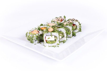 epicurean: Sushi plate on white background. Japanese food. Stock Photo