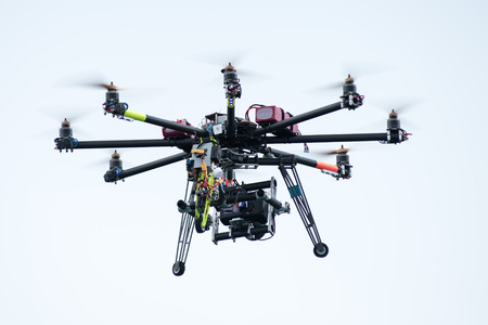 UAV or drone with a digital camera mounted on it