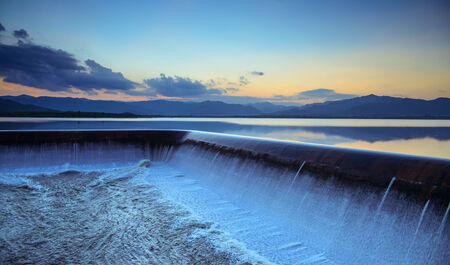 overflow: Water overflow into a spillway Stock Photo
