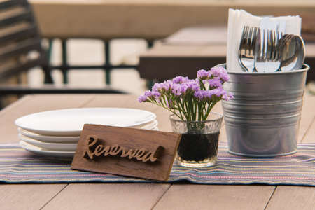 reserved sign: Reserved sign on a restaurant table Stock Photo