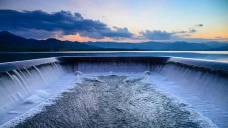 Water overflow into a spillway Stock Photo