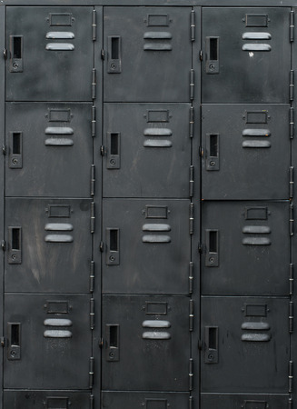 Rows of old black lockers Stock Photo
