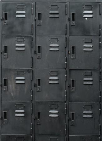 school gym: Rows of old black lockers Stock Photo