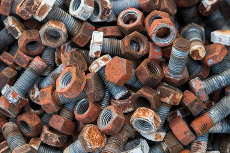 Rusty steel nuts and screws photo