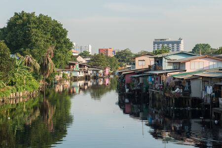 encroaching: April 1, 2015 - Lat Phrao, Bangkok: Houses around Lat Phrao canal. Houses encroaching on the canal are going to be demolished to make way for embankments along both sides of the canal to prevent flooding.