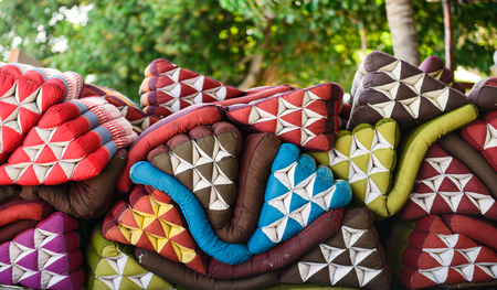 Pile of Thai style triangle pillows Фото со стока