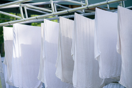 laundered: White towels on clothesline Stock Photo