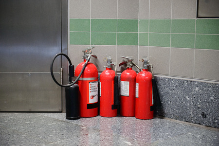 Fire extinguishers in room corner