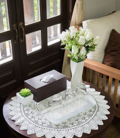 side table: Side table arranged with tablecloth and flowers