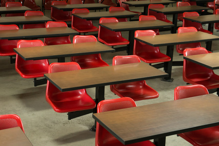 Empty classroom fill with red lecture seats
