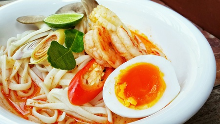 Thai style noodle, Tom Yum seafood noodle soup with egg. Reklamní fotografie