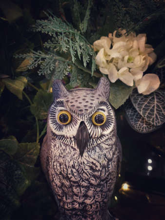 Halloween scene : Cute owl figure sculpture made from paper mache decorated with multi flower and tree branch Zdjęcie Seryjne