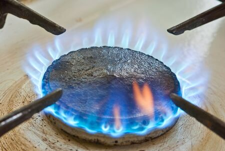 natural gas prices: Blue flames from burner Stock Photo