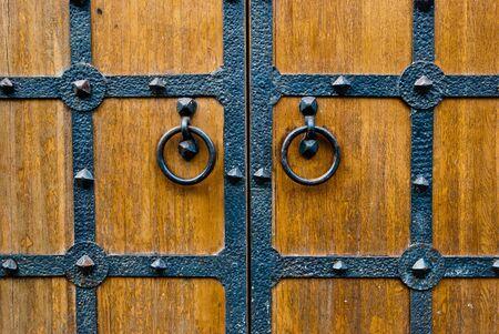 Wooden vintage door with metal door handle, old medival style taken in Moscow, Russia  Stock Photo