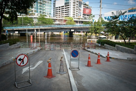 BANGKOK - NOVEMBER 7 2011: Siam Commercial Bank headquarter entrance is blocked after impact with heaviest flood and rain in 20 years in the capital on November 07, 2011 in Bangkok, Thailand.
