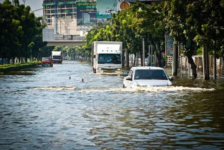 BANGKOK - NOVEMBER 7 2011: Large truck carried flood victims after impact with heaviest flood and rain in 20 years in the capital on November 07, 2011 in Bangkok, Thailand.