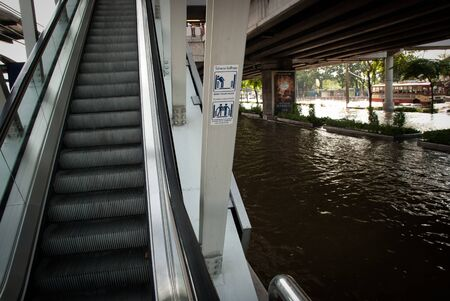 BANGKOK - NOVEMBER 7 2011: Bangkok sky train entrance after impact with heaviest flood and rain in 20 years in the capital on November 07, 2011 in Bangkok, Thailand.
