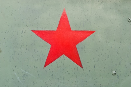 Red army symbol on green metal background texture.