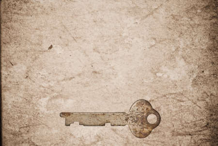 Rusty keys on old paper background with blended layers Stock Photo