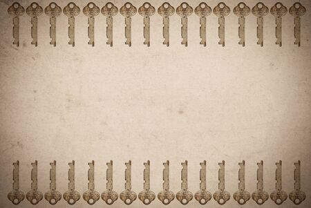 Rusty keys on old paper background with blended layers  photo