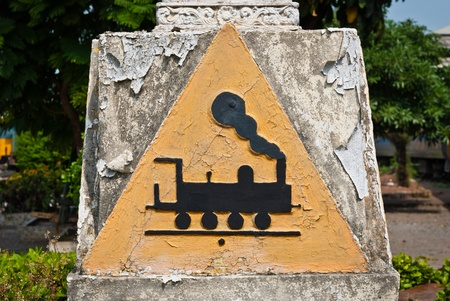 Concrete triangular train symbol, can be use for train related sign and symbol  photo