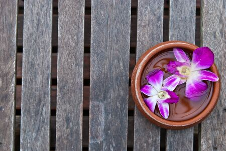 Thai orchid on wood platform with water on top, can be use for health and beauty related concepts