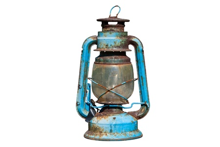 Old rusty oil lamp in isolated white background photo