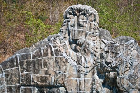 guarding: Large lion stone sculpture, taken on sunny afternoon