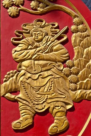 Chinese golden wall art work on red wood, can be use for related chinese concept design photo