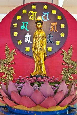 Golden Chinese goddess on dark ackground Stock Photo