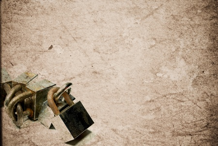Rusty old aged padlocks on vintage paper background Stock Photo - 13408890