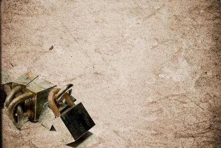 Rusty old aged padlocks on vintage paper background Stock Photo - 13408890
