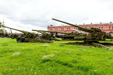 Old vintage Russian artillery systems and equipment on green grass taken on a sunny day, can be use for various military purposes Editorial