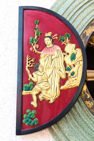 Chinese temple golden window with chinese symbolic drawing photo