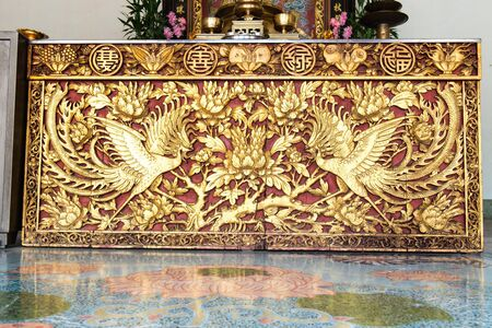 Ancient golden Chinese temple scuplture with symbolic pattern Stock Photo - 16287081