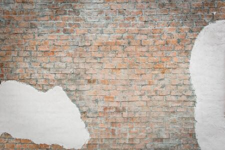 Brown brick wall with white painted concrete pattern, useful for background design photo