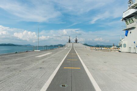 run way: Concrete fighter jet run way of an aircraft carrier, taken on a sunny day in Thailand