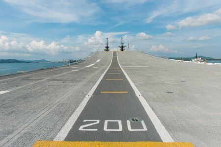 Concrete fighter jet run way of an aircraft carrier, taken on a sunny day in Thailand photo