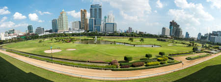 Golf course in the city of Bangkok taken in panoramic technic, on a sunny day