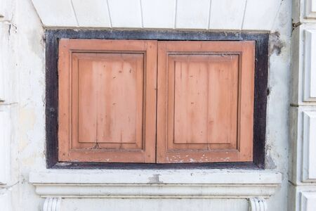 Very old vintage wooden traditional asian home windows, taken at front view