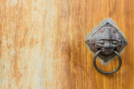 Old vintage chinese temple wooden door with metal chinese door handle photo