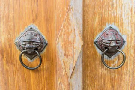 Old vintage chinese temple wooden door with metal chinese door handle photo