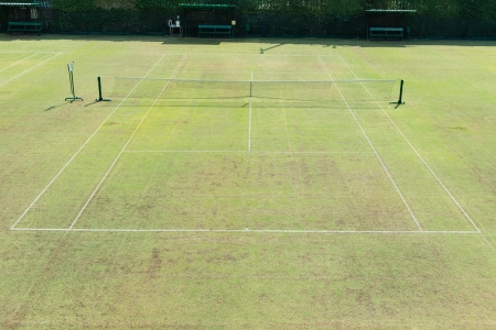 Traditional english out door grass tennis court, taken on a sunny day photo