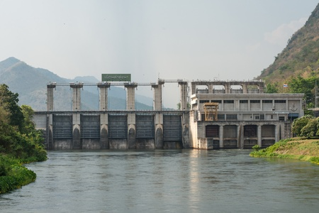 medium size: Medium size dam with metal water gate in Thailand, taken on a cloudy day