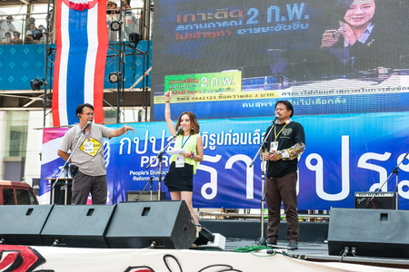 undemocratic: BANGKOK - FEBRUARY 2: 3 unidentified people talking on stage for Thailands protest against the government at central Bangkok on February 2, 2014 in Bangkok, Thailand.