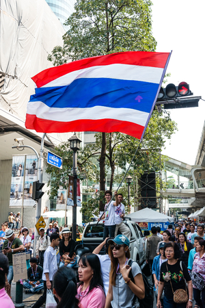 undemocratic: BANGKOK - FEBRUARY 2: Unidentified male waving Thai flag for Thailands protest against the government at central Bangkok on February 2, 2014 in Bangkok, Thailand.