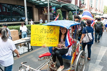 undemocratic: BANGKOK - FEBRUARY 2: Unidentified woman riding tricycle for Thailands protest against the government at central Bangkok on February 2, 2014 in Bangkok, Thailand.