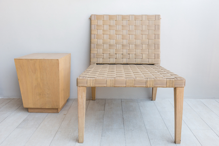 Garden light brown chair made from bamboo texture with wooden coffee table on the side.