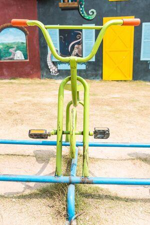 Traditional children bike in children playground, taken outdoor on a sunny day